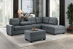This set comes with a sofa and reversible chaise with fabric upholstery and a drop down back with tray table, Ottoman features fold up storage area. Sectional measures x 8 Power Reclining Loveseat, Reclining Sectional, Sectional Sofa, Dark Grey Sectional, Grey Ottoman, Brown Sofa, Corner Sectional, Affordable Furniture, Grey Fabric