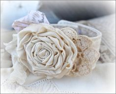 Cream Rose Cuff Bracelet - 24.00 - This is a gorgeous  handmade cuff bracelet ~  It has been embellished  with a silk rose, ribbons, lace  and pearls ~  It has a cream colored  band and a cream rose ~  It has a Velcro and button  closure and measures 8.5 inches  but it can be adjusted with  the Velcro slightly ~ http://www.katiesrosecottagedesigns.com