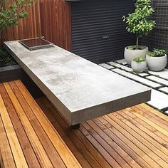 FLASHBACK ⚡️ FRIDAY _______________________________________________________ Massive outdoor dining / BBQ benchtop with random lineal steppers. Designed by Landscaping by _______________________________________________________ Concrete Bench Top, Concrete Dining Table, Concrete Furniture, Poured Concrete, Concrete Art, Outdoor Areas, Outdoor Dining, Outdoor Decor, Concrete Architecture