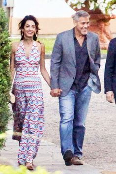 Amal Clooney in a very patriotic patterned maxi dress out in Lake Como, Italy with George Clooney.