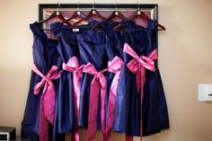 The dresses are actually awful but I like the idea of doing pink ribbons on navy dresses
