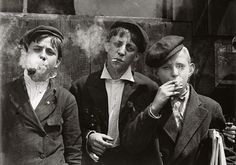 Child labour.. 1880  This picture shows a group of young boys smoking cigarettes and pipes - some of the harmful effects of child labour.