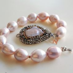 #Swarovski #crystal with #Baroque #pearl station.. find us at: https://www.etsy.com/shop/Njewelshop?ref=hdr_shop_menu