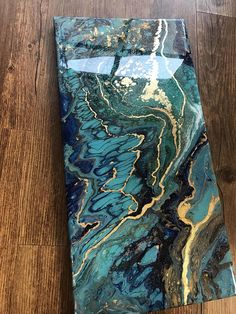 This year, I discovered abstract painting using fluid acrylics. I love the organic feel of this medium and the way it makes images that looks like things in nature. This one looks like turquoise and lapis lazuli to me. It has composite gold (copper and zinc) leaf to add flash and