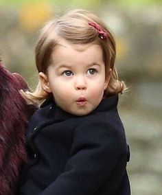 HM The QUEEN has her own adorable mini-me in Princess Charlotte. The resemblance is striking.