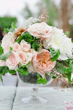 peach and white floral centerpieces See more of this rustic wedding here. http://www.weddingchicks.com/2013/07/03/elegant-colorado-river-wedding/