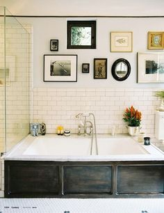 Bathroom with eclectic gallery wall