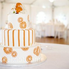 The citrus color scheme went to the next level for the cake, which was decorated -- and flavored -- orange. Fresh fruit and flowers topped it off. Fruit Wedding Cake, Wedding Cake Photos, Themed Wedding Cakes, Wedding Desserts, Wedding Pictures, Orange Party, Orange Wedding, Take The Cake, Summer Fruit
