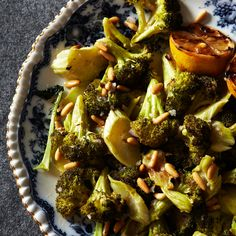 simple dinner party idea, sidedish. Roasted broccoli with lemon and pine nuts. ...1 large head of broccoli (1 1/2 pounds), cut into 1 1/2-inch florets, stems peeled and sliced 1/4 inch thick 1/4 cup extra-virgin olive oil Kosher salt Freshly ground pepper 1 1/2 tablespoons pine nuts 2 teaspoons fresh lemon juice 1 teaspoon minced shallot