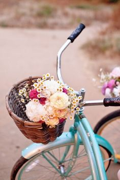 flowers in bike basket. the possibilities are endless.