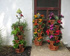 These Vertical Stackable Planters are pure genius. They are self watering so perfect for herbs and flowers and the price is irresistible! Check out how to make your own Terracotta Pot Flower Tower as well!