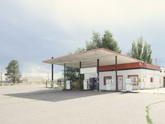 Photographer captures 26 abandoned gasoline stations across America Old Gas Stations, New York Photographers, Photo Projects, Abandoned, Gazebo, Branding Design, Outdoor Structures, America, Outdoor Decor