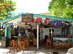 The Soggy Dollar Bar on Jost Van Dyke!  Home of 'The Pain Killer' drink .... and yes, it lives up to it's name :)