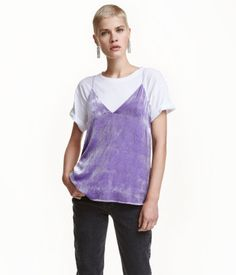 Purple. V-neck camisole top with a sheen. Double layers of fabric over bust and narrow, adjustable shoulder straps.