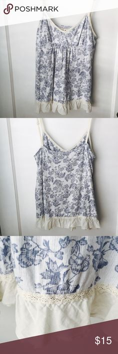 Ambercrombie & Fitch Tank Top Blue floral pattern with a rustic lace trim is beautiful for spring and summer! Nearly zero signs of wear. ***Tag shows it's a medium but it fits more like an extra small/small. Abercrombie & Fitch Tops Tank Tops