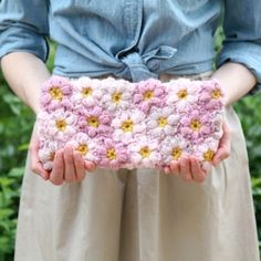 An adorable crochet clutch made of Mollie Flowers! (Inspired by Pouf Purse pattern from Crochet Today!)