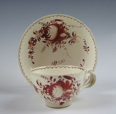 18th C. English Leeds Pottery Creamware Cup & Saucer  some wear to the enamel as you can see in the photos and there is chipping with some associated discoloration to the foot rim of the cup, otherwise fine.  No other damage and no repair. £148.00  USA