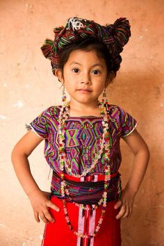 Little Ixil the Maya girl was in Guatemala and is seen in full Mayan clothing. She wears a rainbow beaded necklace and many intricate multi-coloured cotton cloths We Are The World, People Around The World, Around The Worlds, Cultures Du Monde, World Cultures, Beautiful Children, Beautiful People, Amazing People, Population Du Monde
