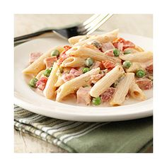 Creamy Ham and Penne Pasta | 8 oz dry penne (use whole wheat!), 1/2 cup frozen green peas (or more, whatever), 1 can Rotel drained, 8 oz neufchatel cheese, 1/2 cup shredded sharp cheddar, and 3/4 cup fully cooked lean ham