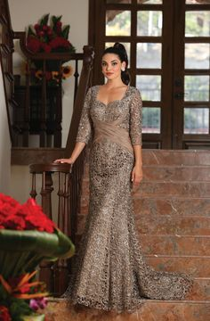 This shimmery elegant mother of the bride dress comes with 3/4 sleeve, sweetheart neckline, sequins and lace material. This dress is great for wedding, evening party and other special occasion. Fabric : Lace Zipper Back Length : Full Length Sleeve Style : 3/4 Sleeve Colors : Mauve, Charcoal Gray, Cappuccino Sizes : M, L, XL, 2XL, 3XL, 4XL, 5XL Fully Lined Soft Cup Inserts Occasion : Formal, Evening Party, Mother of the Bride, Mother of the Groom, Church, Wedding Guest
