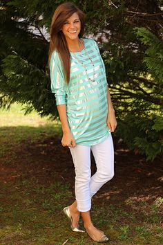 """COMFY and CUTE?!?! YAY!!! This striped dolman features metallic stripes for a stand out look. The mint color looks amazing against white pants. Just add a necklace or big earrings to top off the look! Fits true to size. Miranda is wearing the small. From the shoulder to the hem:  S-31"""", M-32"""", L-32.5"""""""