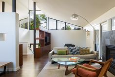 The living room was re-oriented to take advantage of indoor-outdoor living with large sliders and an indoor-outdoor fireplace. The space is now a well-used extension of the living area.