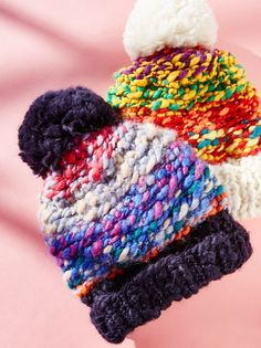 Candy Land Pom Beanie | Cozy knit beanie featuring a multi-colored top half detail with a subtle shimmer strewn throughout. Topped off with an adorable pom pom accent. Fold up the bottom for a closer fit with a touch of cool.