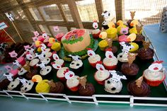 Real Party: Little Lucas Had a Farm. Adorable farm animal themed cupcakes for first birthday party + barn themed birthday cake