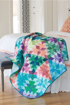 Designer Diane Tomlinson used batiks in the colors of sea glass she picked up on a beach vacation to make this gorgeous quilt. Various sized triangle and pyramid units give this quilt a kaleidoscope effect. Look for Sea Glass in Scrap Quilts Spring '15.