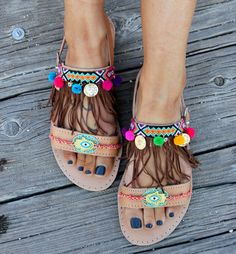Leather sandals handmade to order.  Boho style greek sandals made by genuine leather. They are decorated with bright and colorful little pom poms, handswen friendships and suede and bohemian charms. Make some noise with the eye-catcing Carousel sandals!!   sizes available EU____.....35......36......37......38.......39.......40......41.......42 U.K.___......2....3-3.5.....4.........5........6........6.5.......7........8…