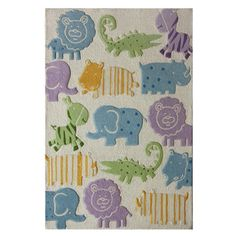 Hand-tufted wool rug with safari animal motif.   Product: RugConstruction Material: 100% WoolColor: