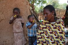 Children eating Mangos, once considered as a cause of malaria in children.