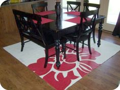 Painted drop cloth for rug- perfect for a craft room or patio (and patio curtains) since it's cheap and durable- tutorial without pictures  http://www.ehow.com/how_5157869_paint-canvas-rugs.html