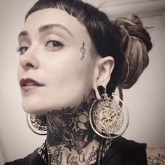 Ear weights and tattoos.