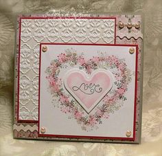 sweet handmade Valentine ... luv the deilicate flower wreath of flowers from Rubber Stamp Tapestry around the heart ... back panel using inked embossing folder technique ... inspired by Belleek ...