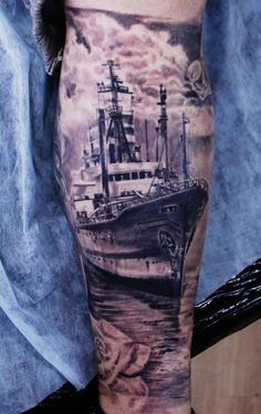 Amazing boat tattoo, check out that realism. Almost like an old photograph