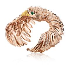 The Eagle Soul Cuff in 18k rose gold with diamonds and emeralds.  #tabbah #houseoftabbah