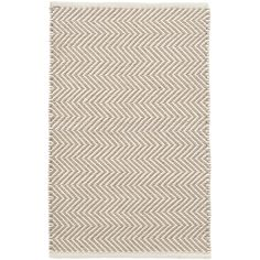 Grey days are no match for this peppy indoor/outdoor rug featuring a grey and ivory zigzag pattern. The thickest of our PET rugs, this durable, easy-care area rug provides geometric interest from the front porch to the back patio and everywhere in between.Made of 100% PET, a polyester fiber made from recycled plastic bottles.