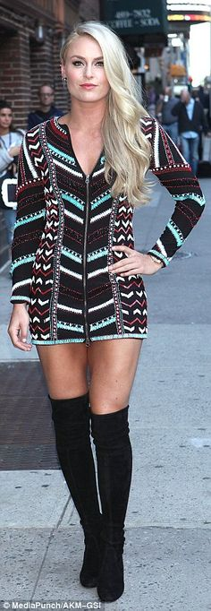 Dared to bare:The alpine ski racer was unmissable in a long sleeve but very short mini dress