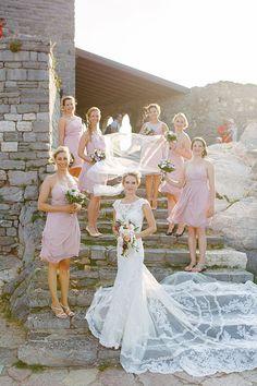 Romantic Portovenere Italy Destination Wedding, Bride and Bridesmaids Outside Church | Brides.com