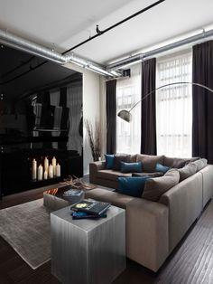 Sofa cinza, almofadas cinza e azul