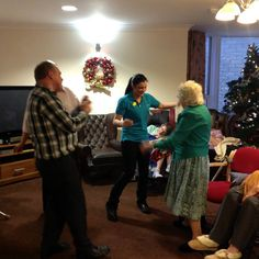 Rocking around the Christmas Tree at Springhill Care Home Accrington