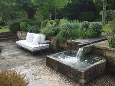 fabulous garden with seating by a rill and pond by vicki archer, provence