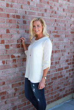 Our perfect knit top is back in these amazing fall colors! We love the roll tab sleeves and the quality knit material. This is a classic top that is perfect to layer with or wear alone.