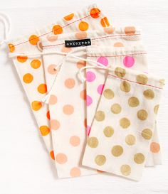 muslin bags with colorful dots /