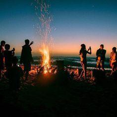 Bonfire at the beach. Click to shop Matthew Williamson beachwear.