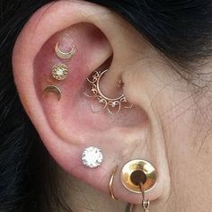 daith, triple helix/flats (bitchin' triple goddess), 3x lobe piercing with stretched lobe. #piercings #earpiercing #daith #triplehelix #helix #stretchedears