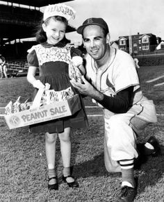 """Mary Mueller sells peanuts to Harry """"Peanuts"""" Lowrey, who was formerly a Chicago Cub, at Wrigley Field on Sept. 22, 1954."""