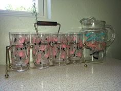 Retro Atomic star burst pink, black, and turquoise pitcher and glasses tumblers MidCentury on Etsy, $65.00