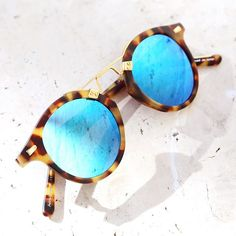 Walking down New Orleans' opulent and colorful Royal Street, you might just miss Krewe's minimalist and charming outpost - likeI did. I only stumbled uponthis little slice of eyewear oasisduring my couple ofhours in NOLA and the only thing that came to mind was: where have you been all this